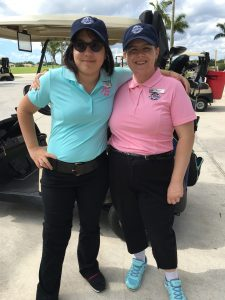 Young adults playing golf at PGA National in Palm Beach Gardens