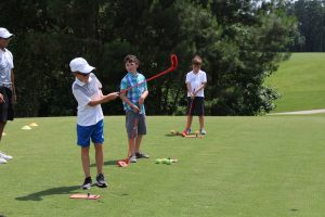 Child with autism playing golf