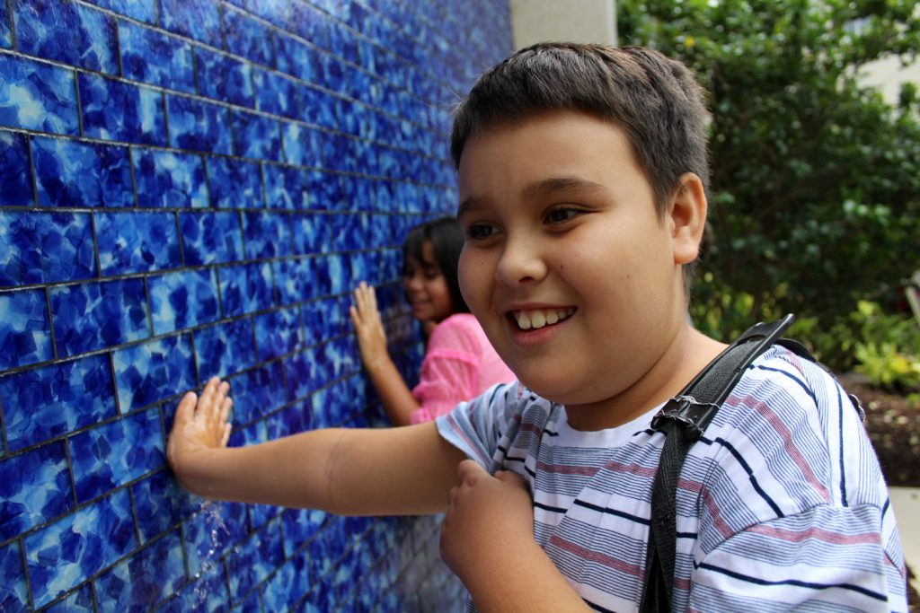Boys Playing in the water wall
