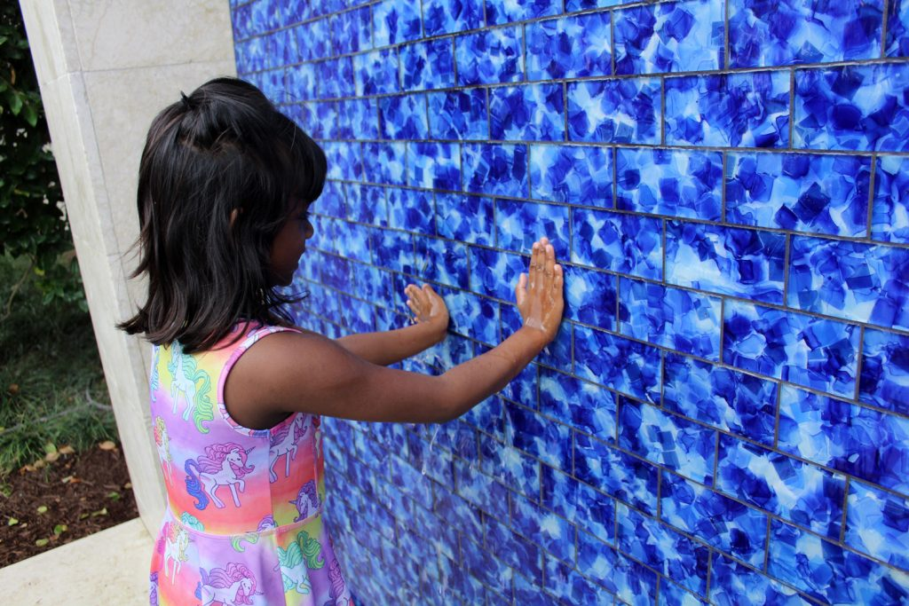 Girl Playing in the Water Wall