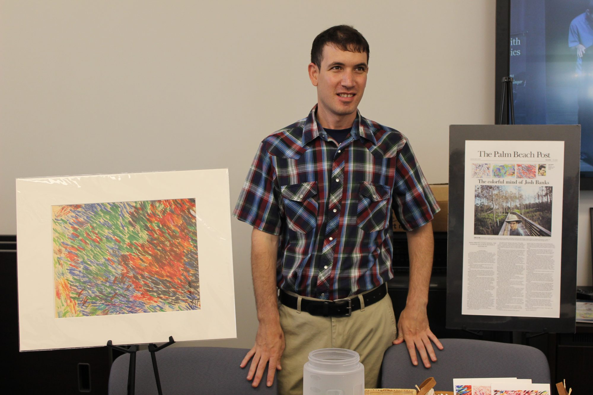 josh silver banks with his paintings